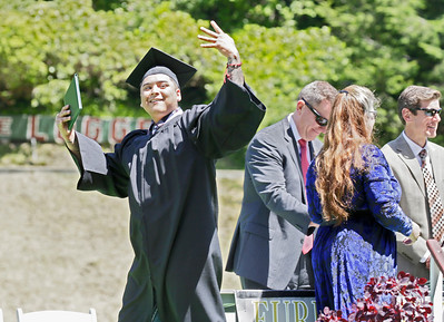 Shaun Walker — The Times-Standard  Zoe Barnum High School graduate David Cruz celebrates after getting his diploma during a ceremony at Eureka High School's Albee Stadium on Wednesday afternoon. About 40 students graduated.