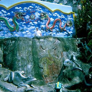 Glen Bernard standing between the dragons at Tiger Balm Gardens (Hong Kong, July 1969)