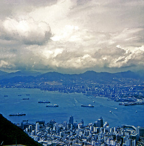 Hong Kong viewed from Victoria Peak and Kowloon across the harbor. China is seen in the distance. (July 1969)