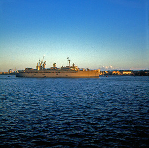Evening sun highlights the bow of the USS Piedmont, at anchor in Kaohsiung Harbor. (July 1969)