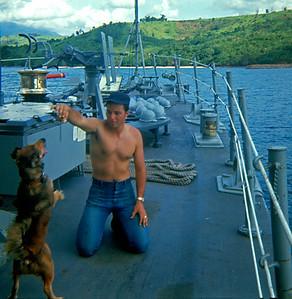 Glen Bernard giving Commodore a treat. (Bininga Bay, PI, 1969)