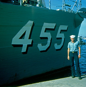 """Standing next to the USS Implicit (MSO 455) is Glen Bernard who just finished ironing on his """"crow"""", now Signalman 3rd Class. (Kaoshung, Taiwan 1969)"""