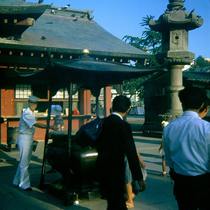 Implicit crewmember PN3 Richard T. Oxley reaches for healing at the temple. (Tokyo, Japan August 1969)