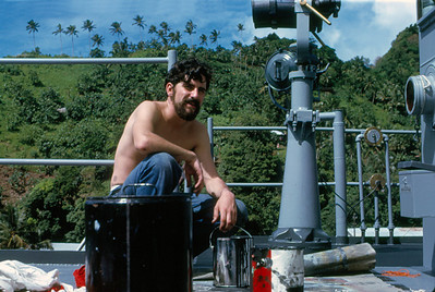 SM3 Jimmy Dant painting the deck of the Signal Bridge on USS Truxtun at Pago Pago in American Samoa, 1971.