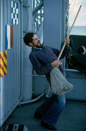 "Back at sea, SM3 Jimmy Dant does a little ""air guitar"" .... make that ""mop guitar"" on the Signal Bridge of USS Truxtun, 1971. Next stop ... Pearl Harbor."