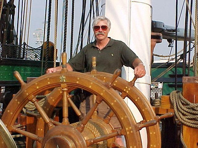 GLEN AT THE HELM OF THE USS CONSTITUTION at Charlestown Naval Yard. (Boston, MA Aug 27, 2000)