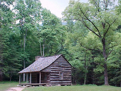 CABIN: Some cabins in Cades Cove, such as this one, are preserved by the park service. (Aug 7, 2000)