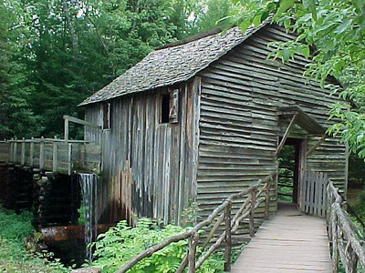 GRIST MILL: Water falls from this flume next to an old mill in Cades Cove, which is missing its wheel. (Aug 7, 2000)