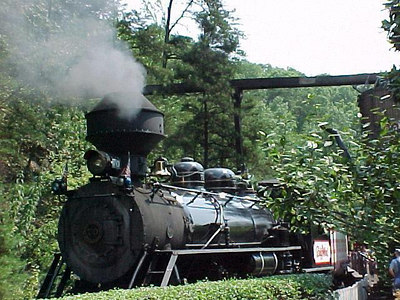 DOLLYWOOD EXPRESS: This smoke-belching locomotive pulls a train of visitors in a perimeter tour of the park. (Aug 8, 2000)
