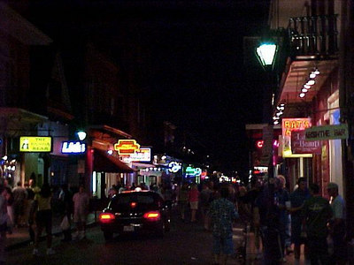 THOUGH RARE, VEHICLES DO SLIP THROUGH THE PEDESTRIAN STREWN BOURBON STREET (New Orleans, Sept 14, 2000)