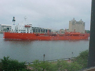 DEPARTING CARGO SHIP From the office windows of the original cotton warehouse (now the River Street Inn), could be observed the arrival, depature, loading and unloading of cargo ships on the Savannah River below. (Savannah's Historic District, Sept 6, 2000)