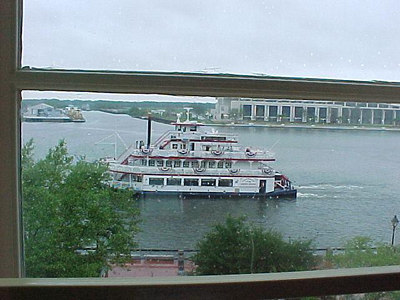 HOTEL ROOM VIEW OF THE SAVANNAH RIVER From the office windows of the original cotton warehouse (now the River Street Inn), could be observed the arrival, depature, loading and unloading of cargo ships on the Savannah River below.(Savannah's historic district, Sept 6, 2000)