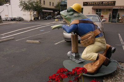 FROGWARE STORE: Around town are frogs representing a variety of businesses. This one, dressed a a builder, is in front of a hardware store.