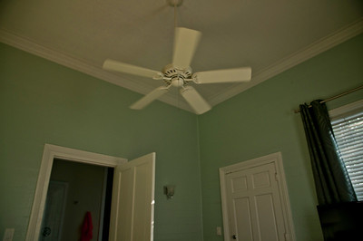 Paddle Fan Turning Slowly On The Tall Ceiling