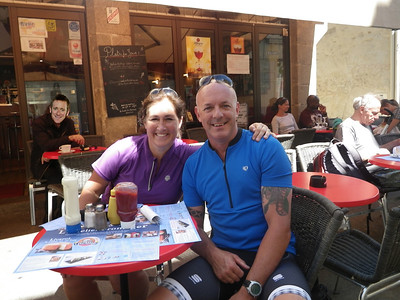 Two great cyclists getting some coffee and carbs. strange bloke behind having a Fag!!