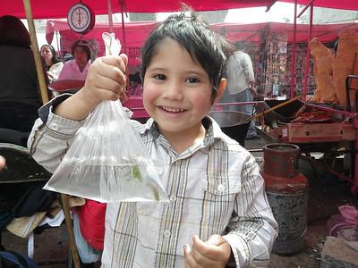 Cute as little boy, market in Mexico city