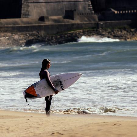 She surfs