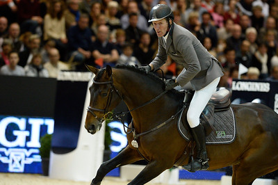 France, Lyon :  Ludger BEERBAUM (GER) riding on CHAMAN  during the Longines Grand Prix 2013  - LONGINES FEI WORLD CUP™- Equita Lyon 2013 - Photo Christophe Bricot