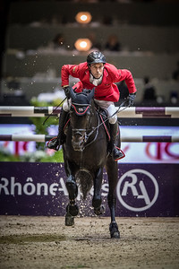 France, Lyon :  Hans-Dieter DREHER (GER) riding on Embassy II  in action during the Longines FEI World Cup™ Grand Prix presented by GL Events in Lyon on November 2th, 2014 - Photo Christophe Bricot