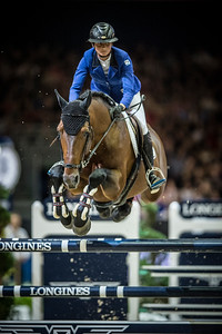 France, Lyon :  Pénélope LEPREVOST riding on Vagabond de la Pomme  in action during the Longines FEI World Cup™ Grand Prix presented by GL Events in Lyon on November 2th, 2014 - Photo Christophe Bricot