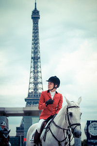 FRANCE, Paris : Charlotte Casiraghi riding on Tintero (victory, first place) during the Longines Global Champions Tour of Paris Eiffel Jumping presented by Gucci 2014 - Champs de Mars , Paris Tour Eiffel (Eiffel Tower)- 04/07/14 - Photo Christophe Bricot.  Editorial Use only. - Please Contact photographer.
