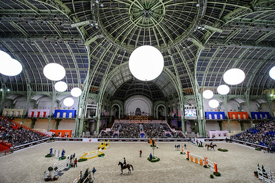 France, Paris : Petronella ANDERSSON riding Ivoor van T Paradijs and Christian AHLMANN riding Colorit  during the Saut-Hermès Jumping competition in the Grand-Palais, on March 18th , 2017, in Paris, France - Photo Christophe Bricot