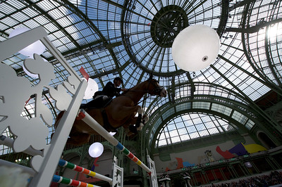 Paris, France : Roger Yves BOST (FRA) riding DAYTON SITTE   during the Saut-Hermès in the Grand Palais, on March 16, 2018, in Paris, France - Photo Christophe Bricot