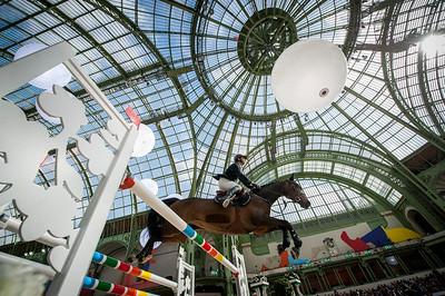 Paris, France : Julien GONIN (FRA) riding UNE ETOILE LANDAISE during the Saut-Hermès in the Grand Palais, on March 16, 2018, in Paris, France - Photo Christophe Bricot