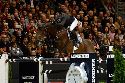 France, Lyon :  Patrice DELAVEAU (FRA) riding on ORIENT EXPRESS  during the Longines Grand Prix 2013  - LONGINES FEI WORLD CUP™- Equita Lyon 2013 - Photo Christophe Bricot