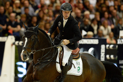 France, Lyon :  Rolf-Goran BENGTSSON (SWE) riding on CASALL ASK during the Longines Grand Prix 2013  - LONGINES FEI WORLD CUP™- Equita Lyon 2013 - Photo Christophe Bricot