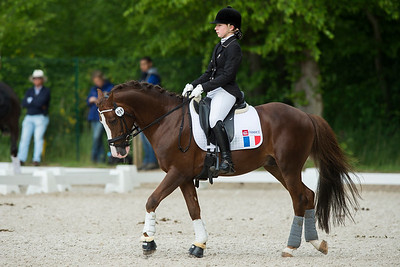 France, Compiègne : Leana Capy (France) riding Olywood De Blonde during the Individual Pony Riders Dressage competition of the CDIY of Compiègne on May 21th , 2016, in Compiègne, France - Photo Christophe Bricot