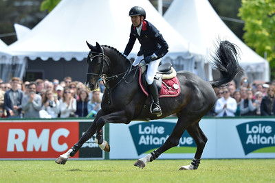 France, La Baule : Simon Delestre riding Qlassic Bois Margot during the Longines International Jumping of La Baule , on May {day th , {year4}, in La Baule, France - Photo Christophe Bricot