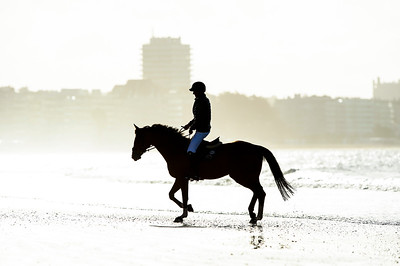 France, La Baule :  Steve Guerdat riding Bianca on the beach during the FEI Longines International Jumping of La Baule , on May {day th , {year4}, in La Baule, France - Photo Christophe Bricot