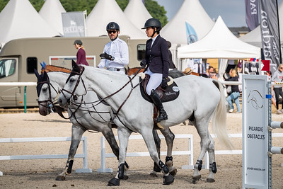 France, Chantilly : Guillaume Canet, riding Wouest de Cantraie Z and Tess Carmichael, riding Berlin's Kojak during the Longines Longines Global Champions Tour of Chantilly, on July 13th , 2019, in Chantilly, France - Photo Christophe Bricot