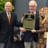 David M. Johnson - djohnson@digitalfirstmedia.com<br /> Chairman Edward Bowen, left, hands National Museum of Racing and Hall of Fame inductee Zenyatta's plaque to her owners, right, Mr. and Mrs. Jerome S. Moss and Chairman Edward Bowen on Friday, July 12, 2016 at the Fasig-Tipton Sales Pavillion in Saratoga Springs.