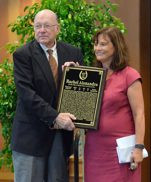David M. Johnson - djohnson@digitalfirstmedia.com<br /> Chairman Edward Bown, left, hands National Museum of Racing and Hall of Fame inductee Rachel Alexandra's plaque to Stonestreet Farm owner Barbara Banke Friday, July 12, 2016 at the Fasig-Tipton Sales Pavillion in Saratoga Springs.