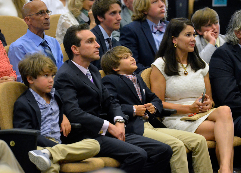 David M. Johnson - djohnson@digitalfirstmedia.com<br /> National Museum of Racing and Hall of Fame inductee Ramon Dominguez, second from left, watches a tribute next to his two sons and wife Sharon, right, Friday, July 12, 2016 at the Fasig-Tipton Sales Pavillion in Saratoga Springs.