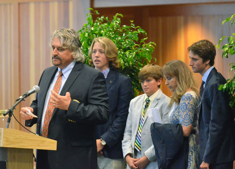 David M. Johnson - djohnson@digitalfirstmedia.com<br /> National Museum of Racing and Hall of Fame inductee Steve Asmussen, left, gives a speech as his family look on Friday, July 12, 2016 at the Fasig-Tipton Sales Pavillion in Saratoga Springs.