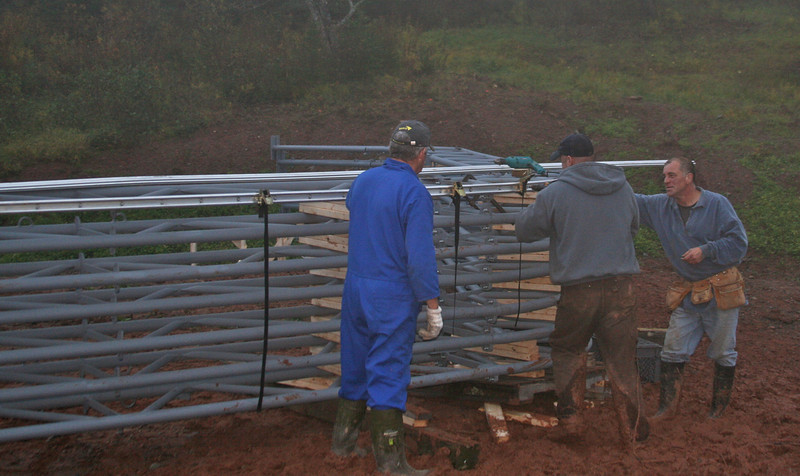 Adding aluminum channel to the trusses.