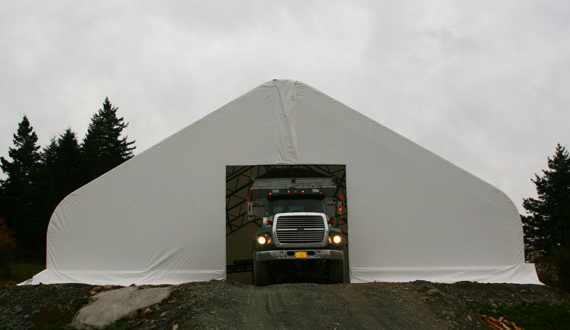 Day 13 (Nov 10, 2010).  One week later, we're back at it. Slinger truck is back with more Class A gravel for the floor...