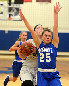 Tania Barricklo-Daily Freeman                      Highland's Cathryn Simmons goes up for a shot and is fouled by Haldane's 25