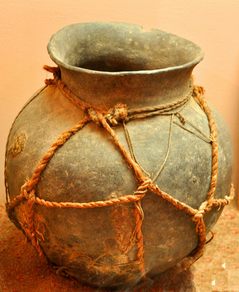 Drinking vessel bound by yucca rope and string.