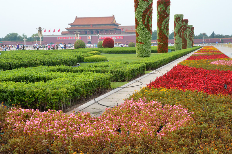 Decorative gardens on the north side of Beijing's Tiananmen Square, with a view of the Tiananmen Gate (Gate of Heavenly Peace) of the Forbidden City.