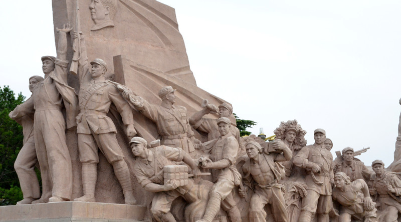Revolutionary themes decorate the entrance to The Mausoleum of Mao Zedong at Niananmen Square in Beijing (2)