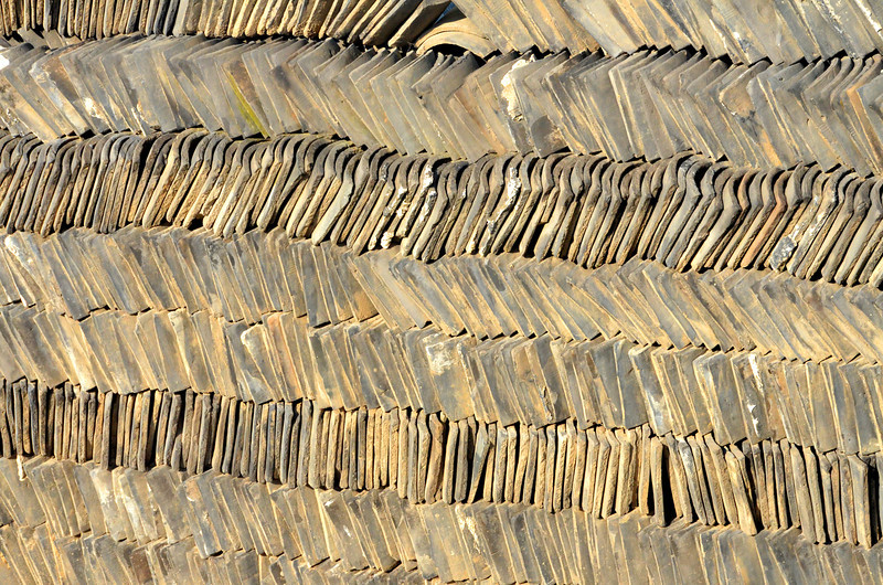 Piles of shale or clay tiles  awaiting use in China