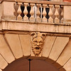 Mask on an entrance just off the Via Zamboni