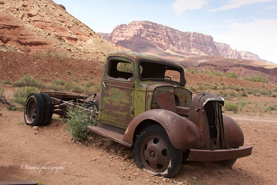 Old 36 truck sitting in the middle of the desert.