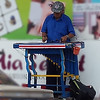 Marimba Player in front of a Store