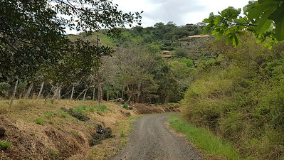 Roca Verde Houses on the hills beyond the road
