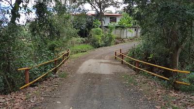 Bridge over stream behind one Roca Verde House